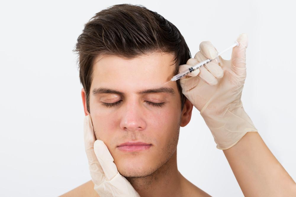 Male model receiving Botox above eyebrow